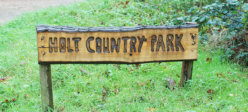Holt Country Park sign