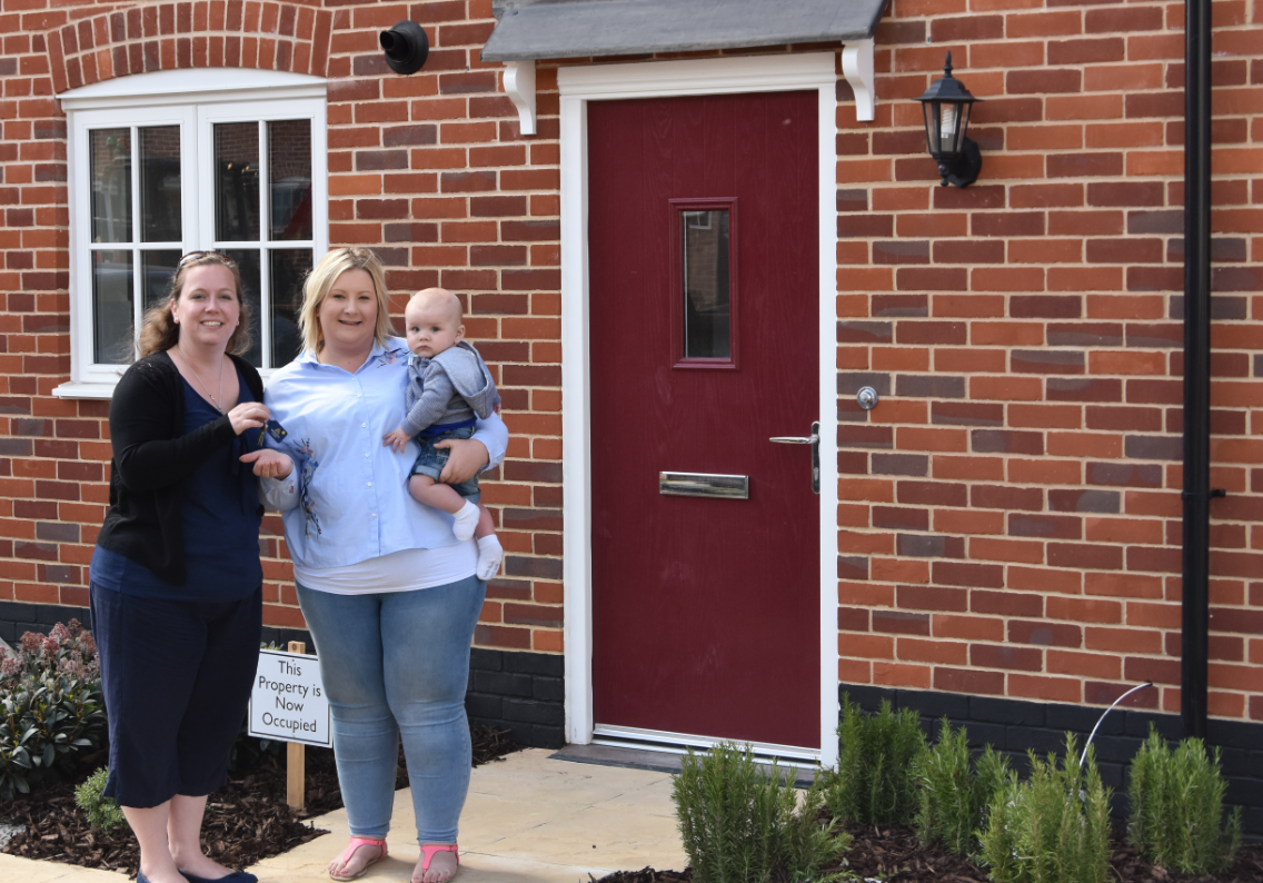 Four homes handed over to Holt Housing Society
