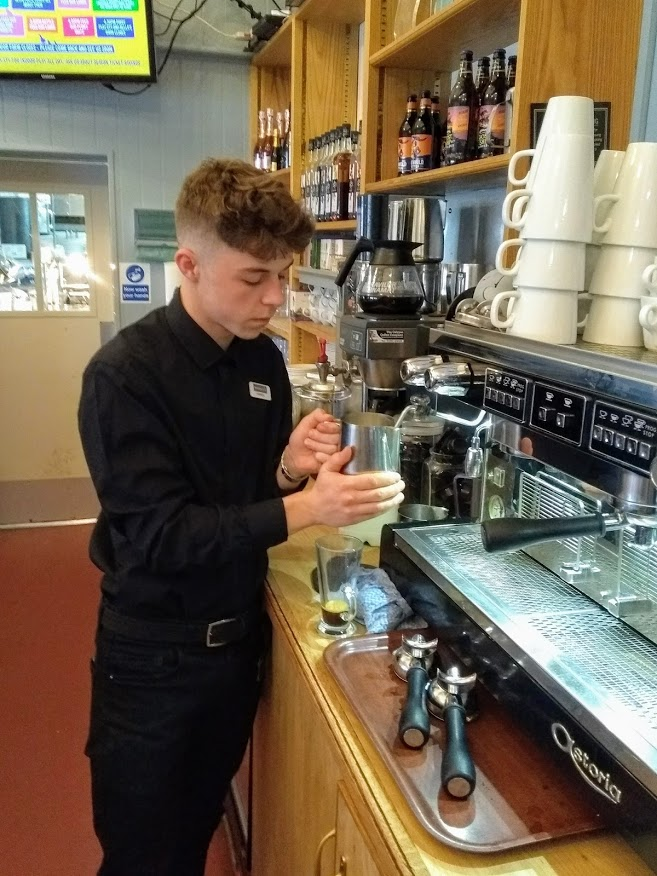 Harrison making coffee