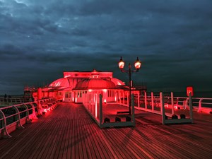 Cromer Pier glows in support of the 'Light It In Red' campaign